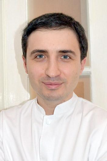 Dr. Haritinian Emil